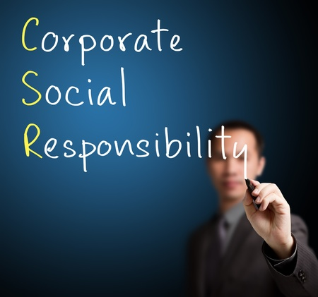 business roles: business man writing corporate social responsibility   CSR   concept Stock Photo