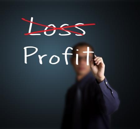 eliminate: business man eliminate loss and make profit Stock Photo