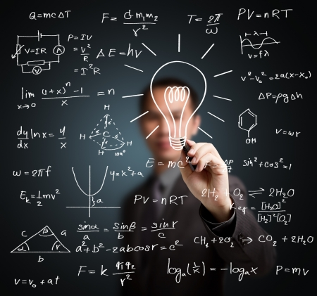 theories: smart teacher writing various high school maths and science formula with light bulb ( symbol of idea and solution ) Stock Photo
