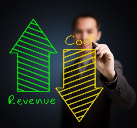 upward graph: business man writing concept of increased revenue and reduced cost