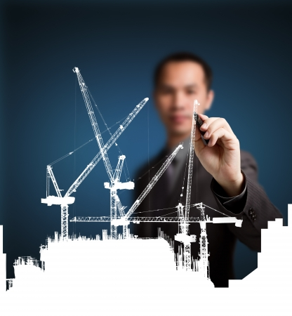 construction project: business man drawing construction site project ( building development ) Stock Photo