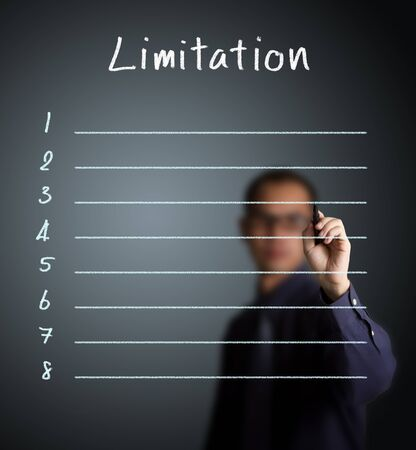business man writing blank limitation list Stock Photo - 14637458
