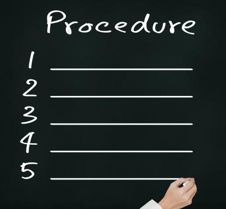 procedures: business hand writing blank procedure list on chalkboard Stock Photo