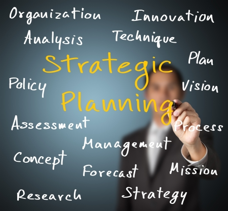 strategic planning: business man writing strategic planning concept