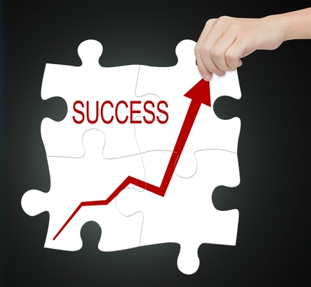 business hand connect success graph on jigsaw puzzle Stock Photo - 14652318