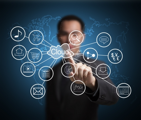 virtual server: business man pointing at cloud computing and connected world wide application network Stock Photo