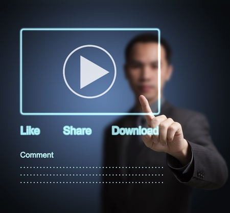 users video: business man pointing at video clip on  social network touchscreen Stock Photo
