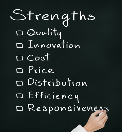 business man writing list of business strength   quality, innovation, cost, price, distribution, efficiency, responsiveness   photo