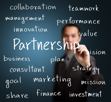 collaborate: business man writing partnership concept