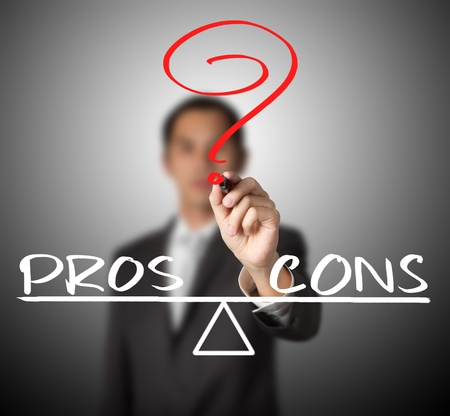 dissent: business man writing pros and cons compare on balance bar
