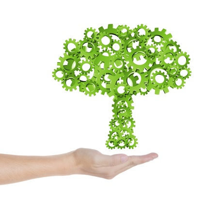 agriculture industrial: hand hold green tree of industrial gear, environmental concept Stock Photo