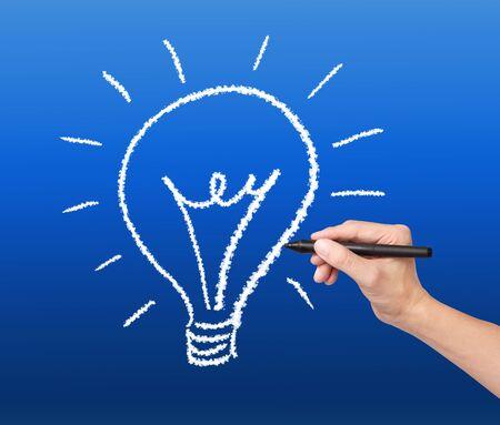 energy management: hand drawing cloud lightbulb on blue sky Stock Photo