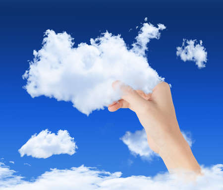 hand holding cloud in blue sky, symbol of cloud computing technology Stock Photo - 15897468
