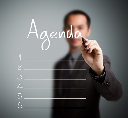 planner: business man writing blank agenda list Stock Photo