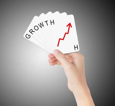 business hand hold cards of growth Stock Photo - 16041716