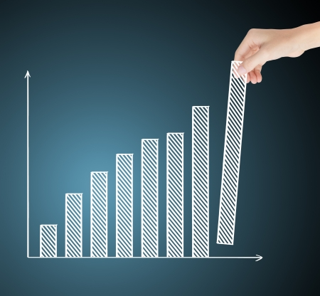 upward graph: business hand building upward trend financial graph