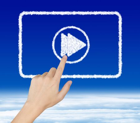 hand pressing fast forward button on cloud video clip photo