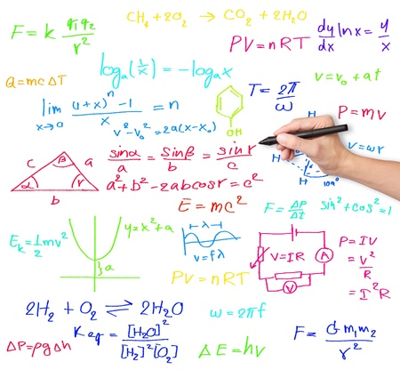 physic: teacher hand writing various high school maths and science formula Stock Photo