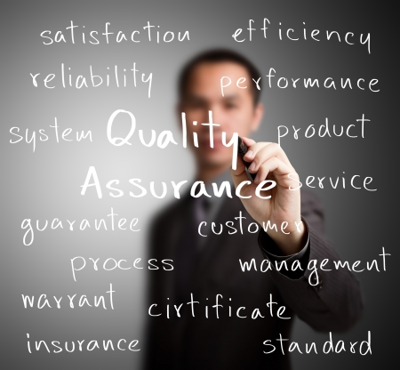 quality assurance: business man writing quality assurance concept