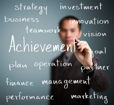 business man writing achievement concept Stock Photo - 24861860