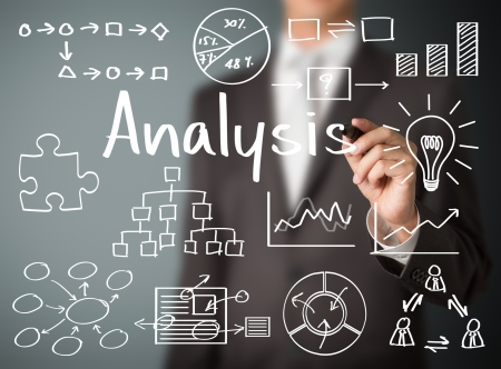 financial analysis: business man writing data analysis