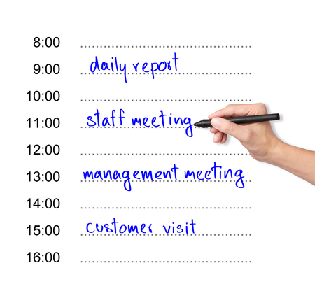 business hand writing daily appointment schedule photo