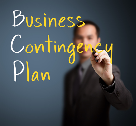 contingency: business man writing business contingency plan