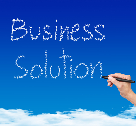 business hand writing cloud business solution on blue sky