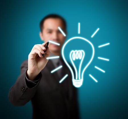 blue bulb: business man drawing idea light bulb