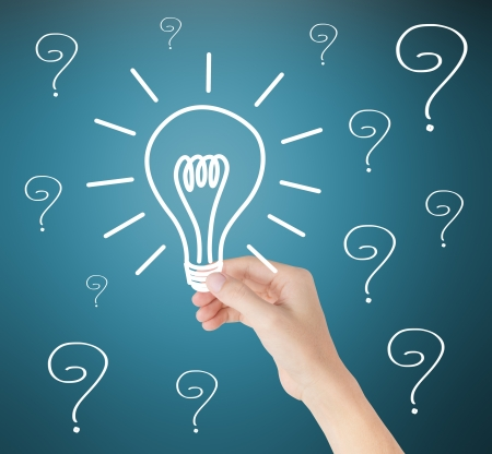 creative answers: hand holding idea light bulb out of problems