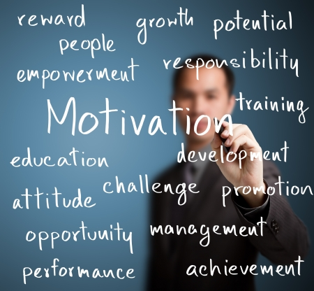reward: business man writing  motivation concept Stock Photo