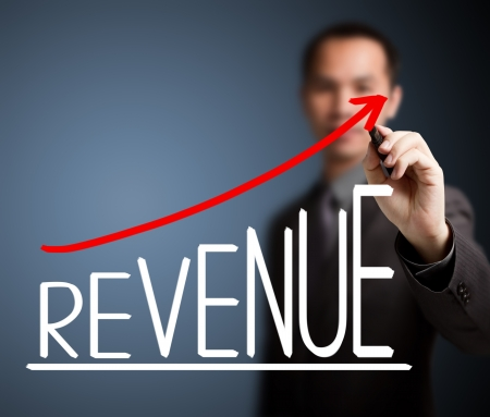 business man writing revenue growth graph photo