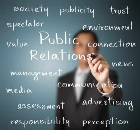 responsibilities: business man writing public relations concept Stock Photo