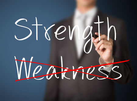 eliminate: business man eliminate weakness and choose strength Stock Photo