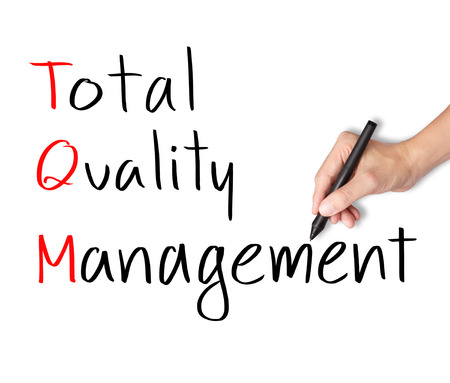 business hand writing total quality management  TQM  concept photo