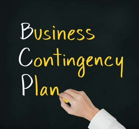 contingency: business hand writing business contingency plan