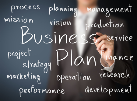 business process: business man writing business plan concept