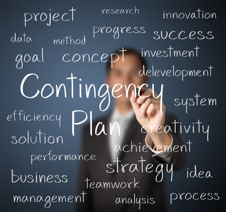 contingency: business man writing contingency plan concept