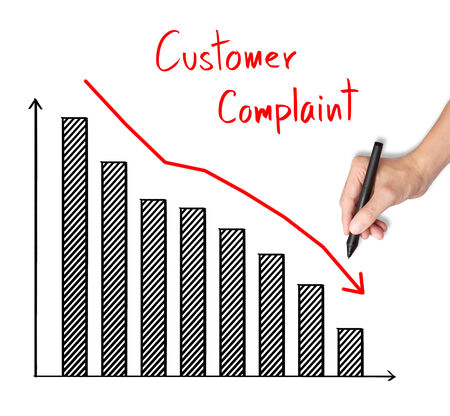 complaint: business hand writing reduced customer complaint graph Stock Photo