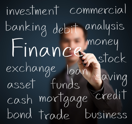 financial education: business man writing finance concept Stock Photo