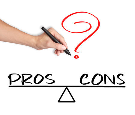 dissent: business hand writing pros and cons compare on balance bar Stock Photo