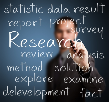 research: businessman  writing research concept