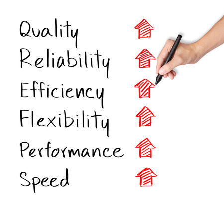 reliability: business hand writing rising reliability, quality, efficiency, flexibility, performance and speed Stock Photo