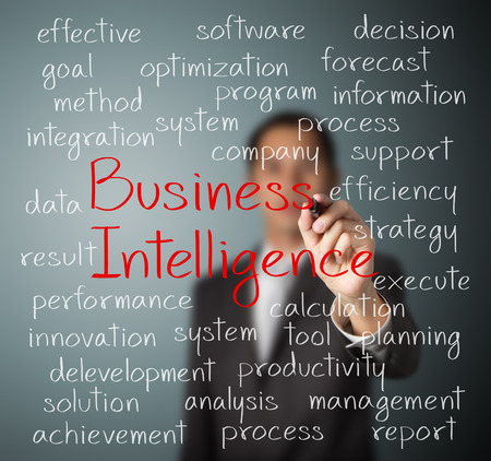 business man writing business intelligence concept photo