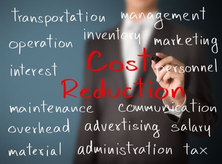 cost reduction: business man writing cost reduction concept