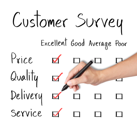 fulfill: business hand evaluate excellence on customer survey form