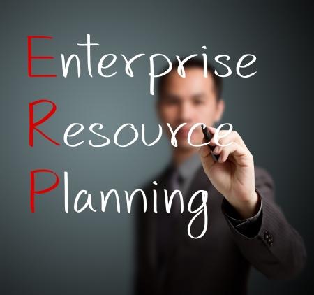 businessman writing enterprise resource planning  ERP  concept photo