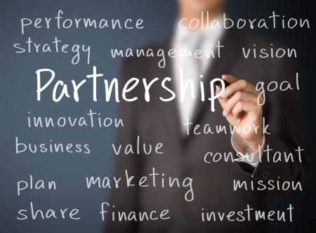 Homme d'affaires écrit notion de partenariat Banque d'images - 25072940