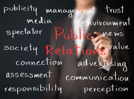 public relations: business man writing public relations concept Stock Photo