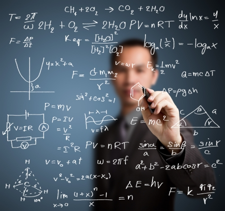 teacher writing high school maths and science formula photo